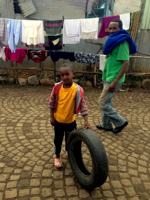 boy with tire